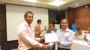 Mr.Chandrasekaran being awarded as Runner Up by Mr.Narasimhan